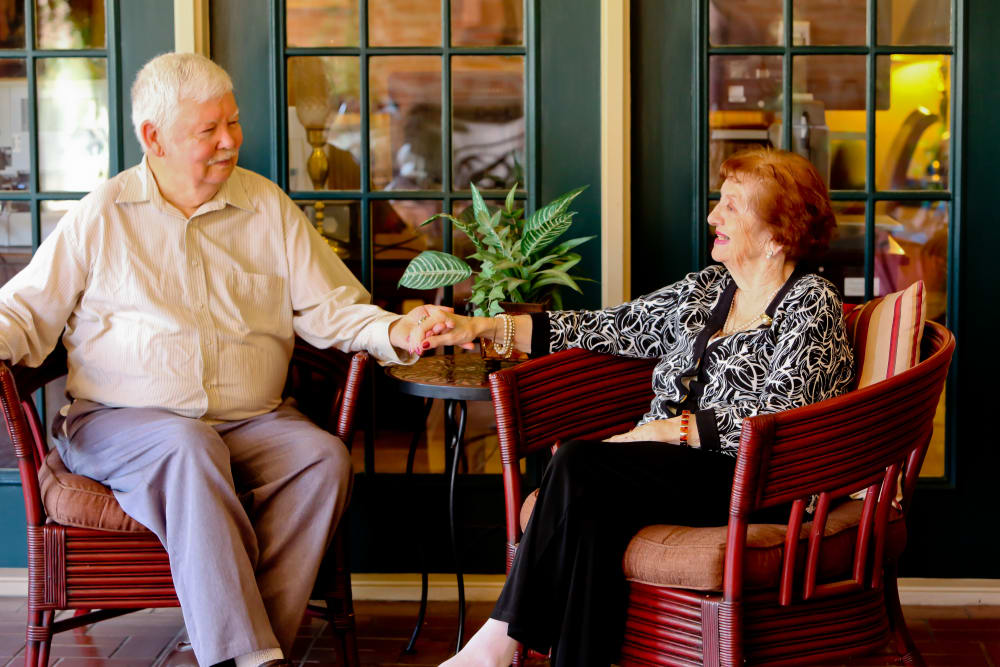 Couple holding hands at Azalea Estates of Gonzales retirement care