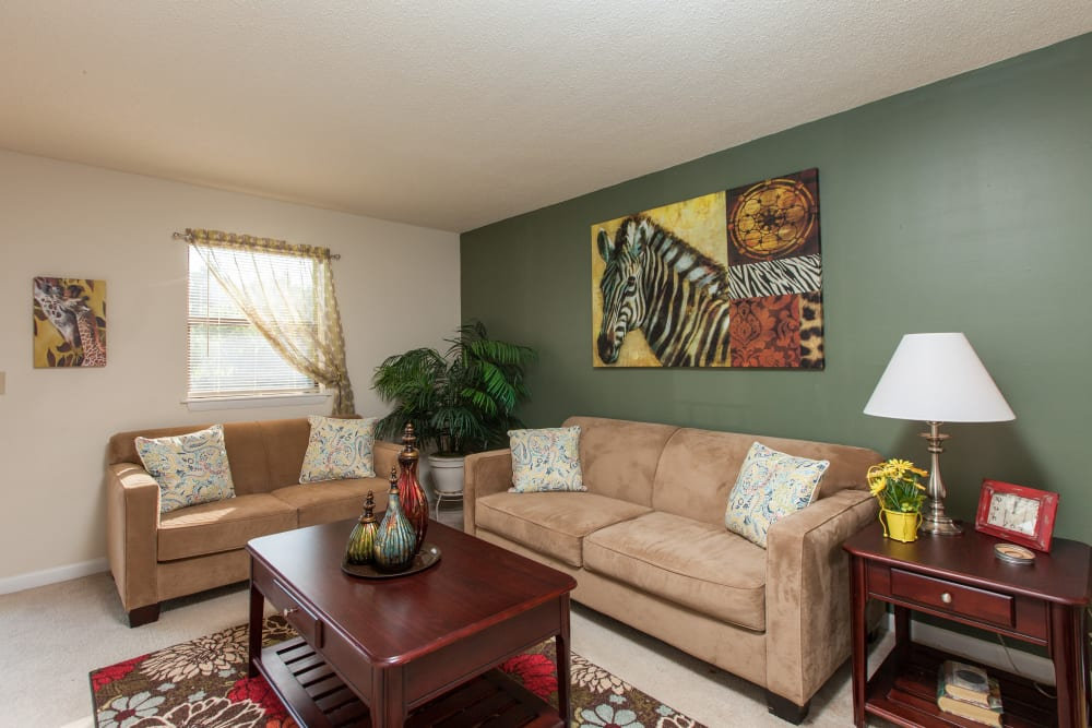 Alternative living room layout with beige couches at Cross Creek Cove Apartments & Townhomes