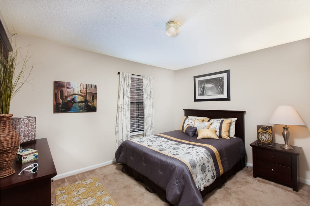 A view of the master bedroom at Cross Creek Cove Apartments & Townhomes