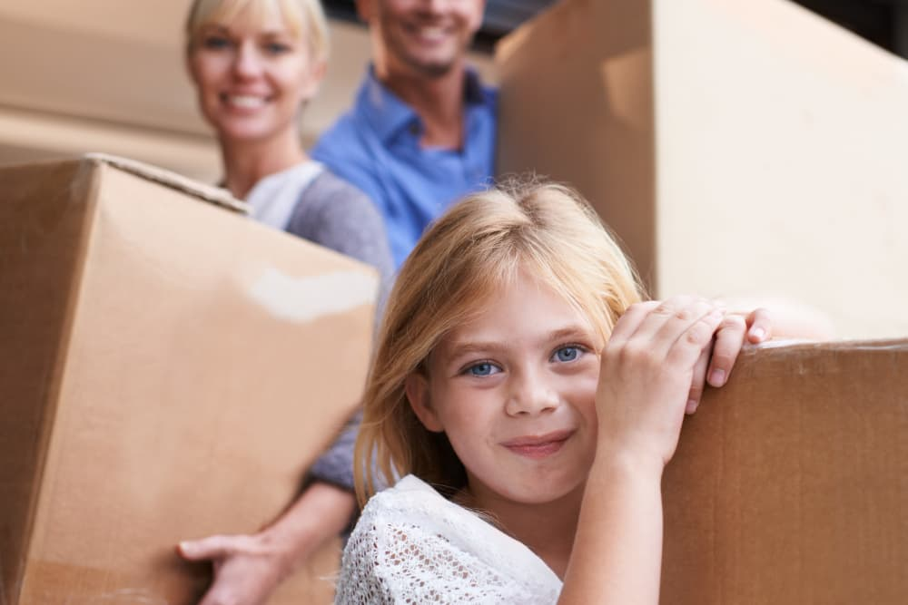 Family packing boxes to storage them at Dominion Self-Storage