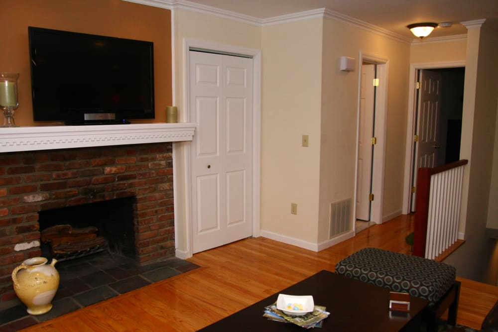 A fireplace and nice hardwood flooring at Brandywyne at Brielle
