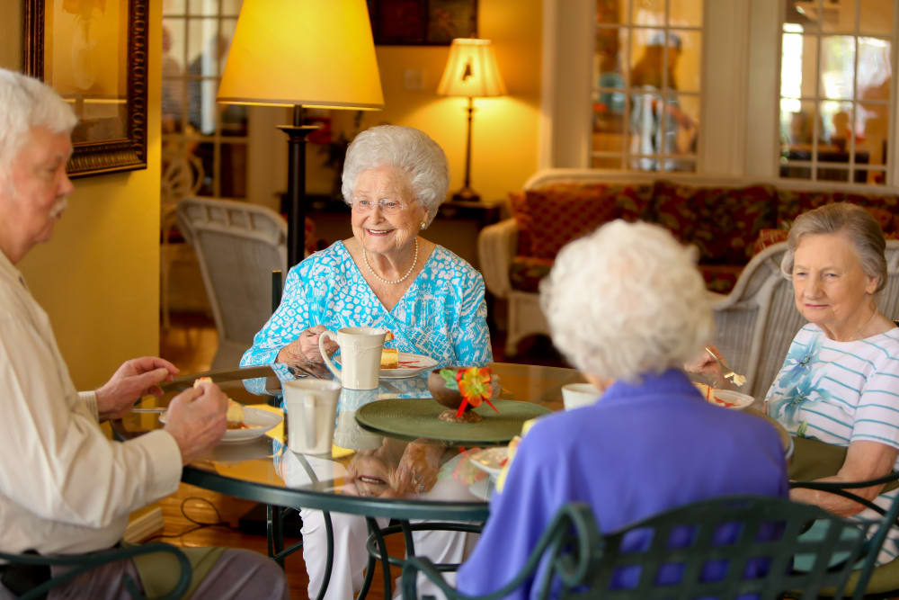 Residents of Azalea Estates of Gonzales eating cheesecake