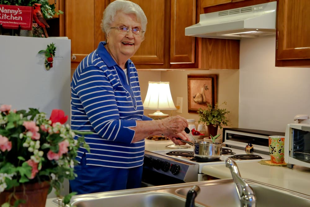 Independent living resident cooking herself a meal at Azalea Estates of Gonzales