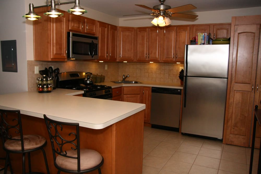 A stainless steel refrigerator and breakfast bar at Center Grove Village