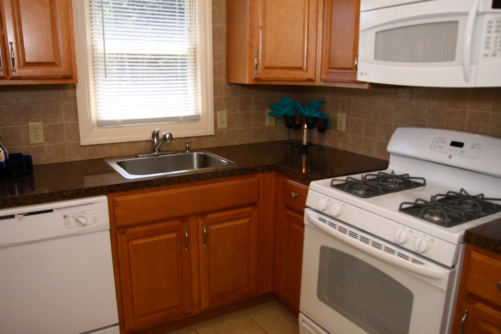 A kitchen with a gas stove at Waterway Court Apartments