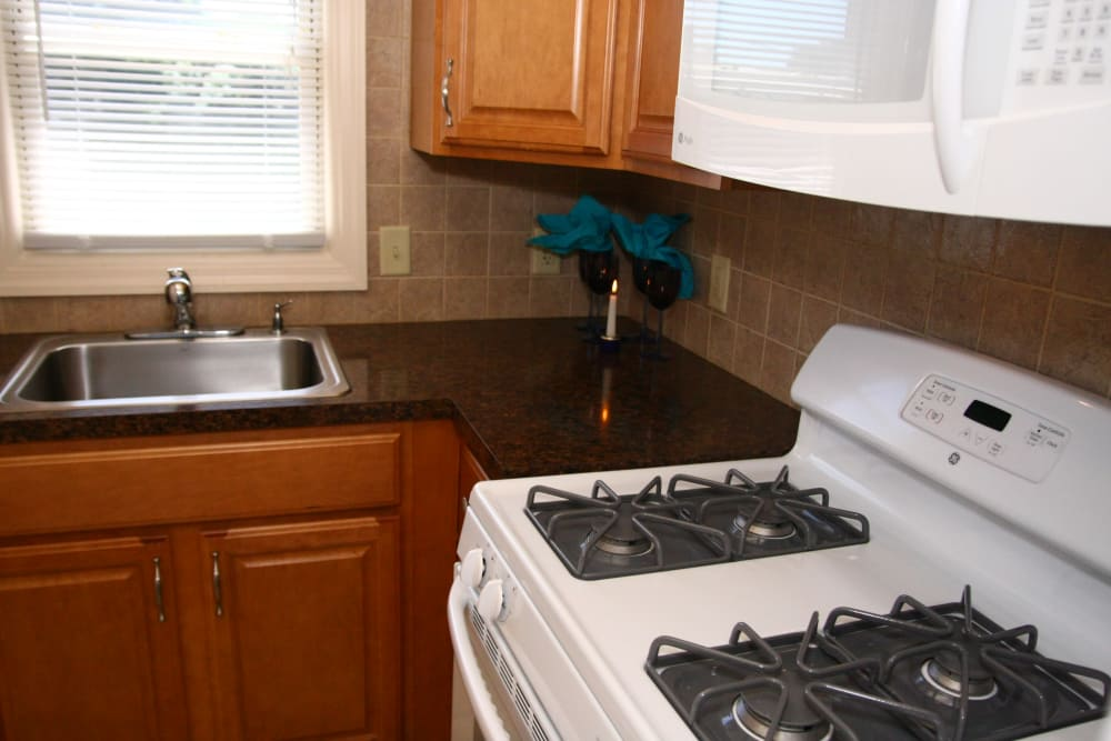 A gas range is offered in the kitchen at Waterway Court Apartments