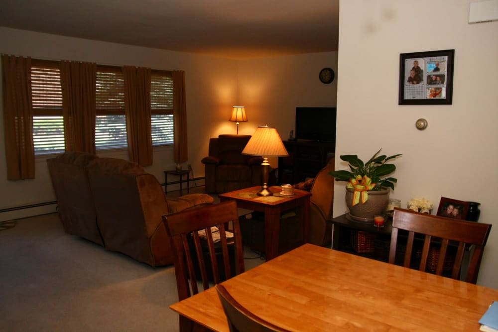 A model home at Waterway Court Apartments with a dining table and sofa