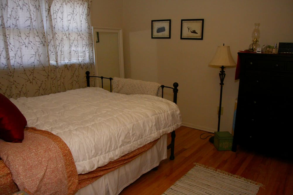 A master bedroom with hardwood flooring at Waterway Court Apartments