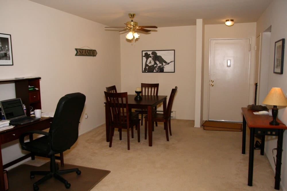 A dining area and desk in the studio home at Brinley Manor