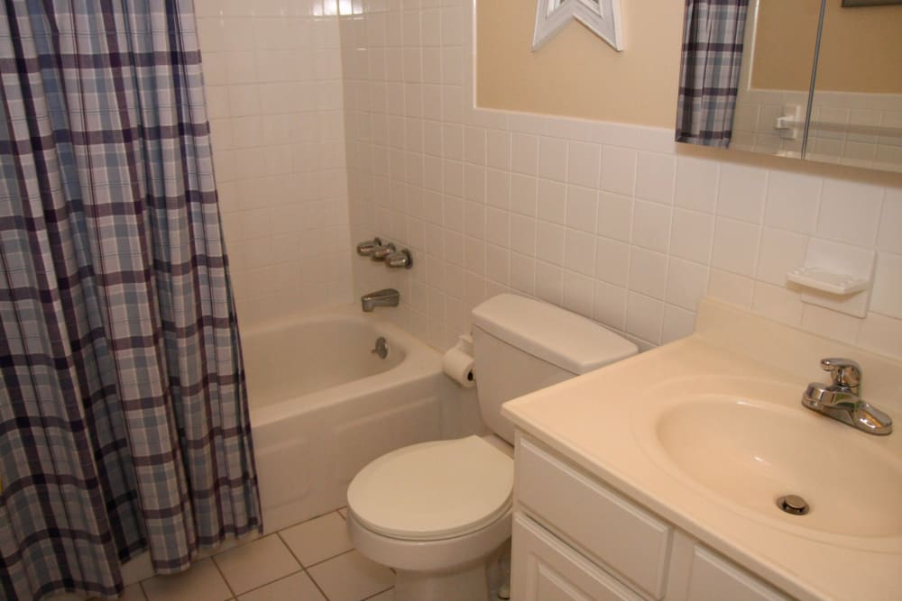 White bathroom and ample storage space at Brinley Manor