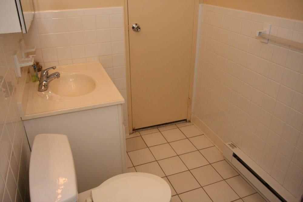 White bathroom interior at Brinley Manor in Bradley Beach