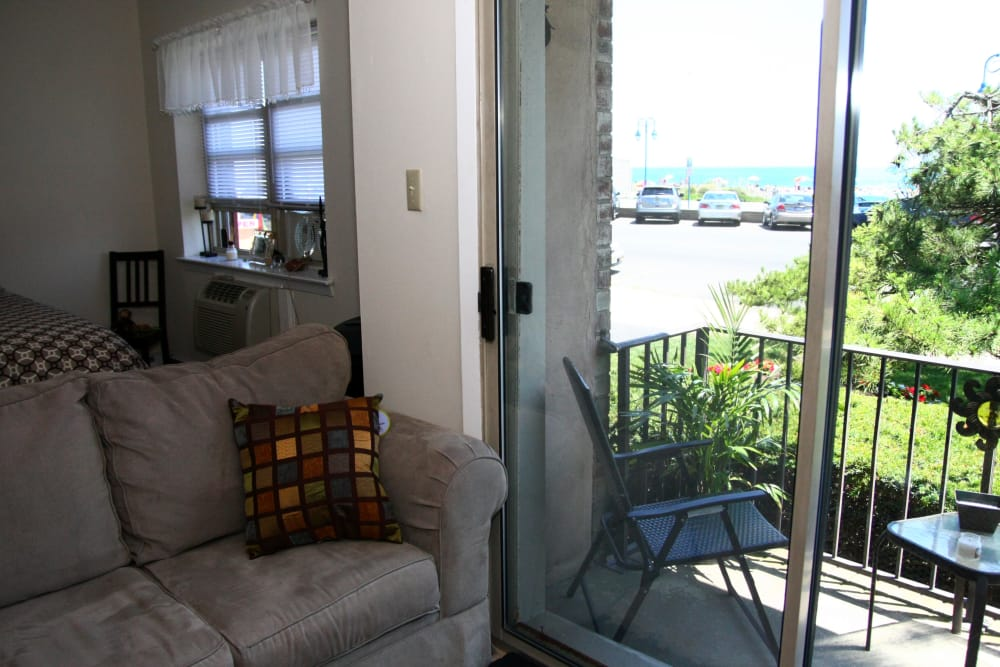 A sliding glass down and private patio at Ocean Harbor Apartments