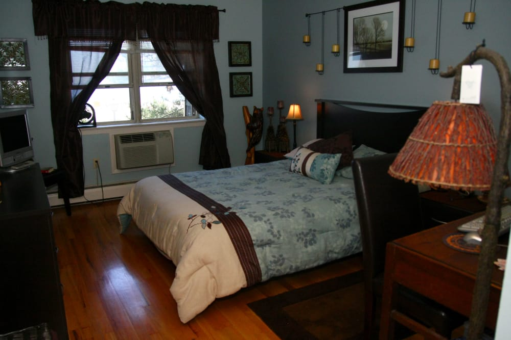 A master bedroom at Ocean Harbor Apartments