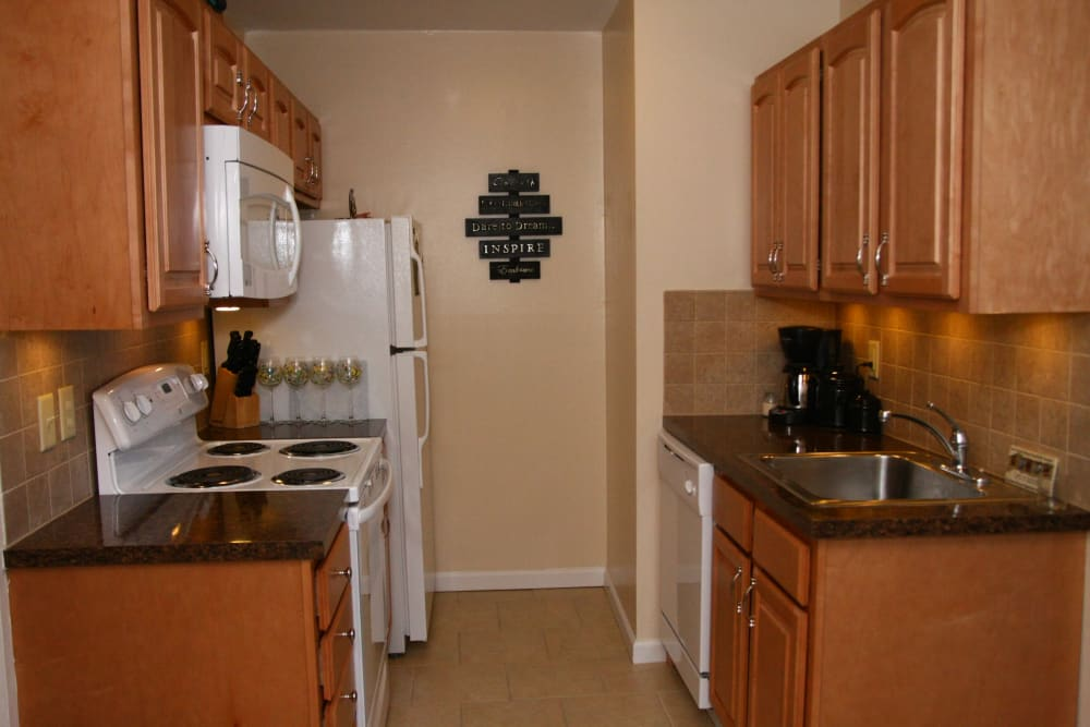A model kitchen with white appliances at Ocean Harbor Apartments