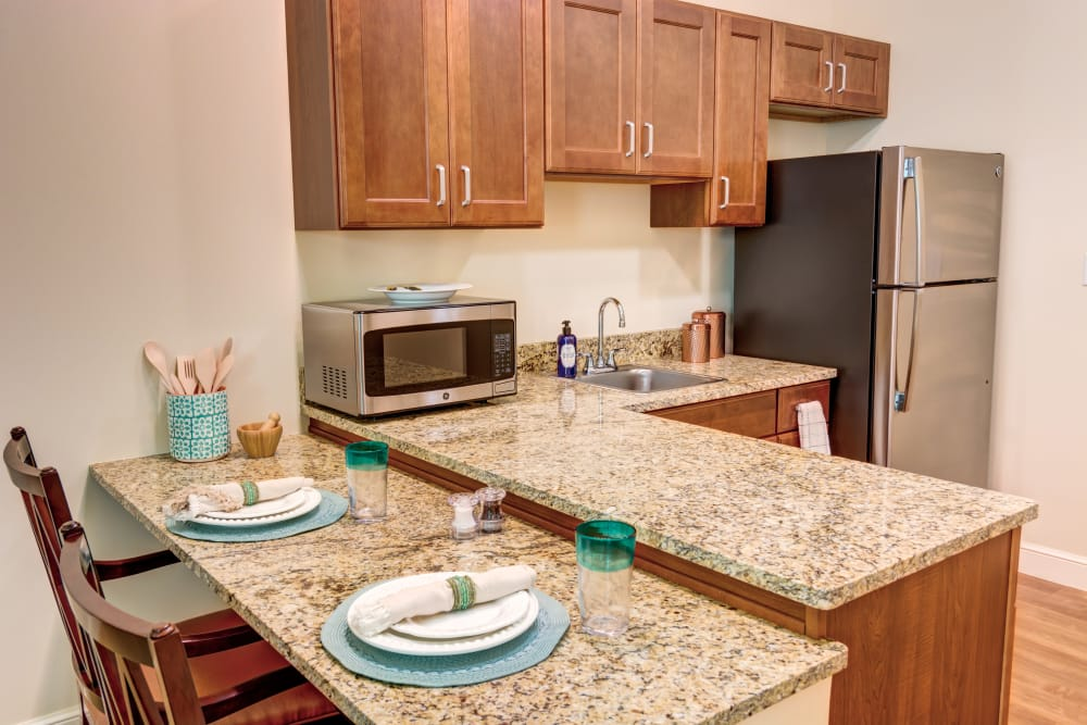 Apartment kitchen at Symphony at Stuart in Stuart, Florida