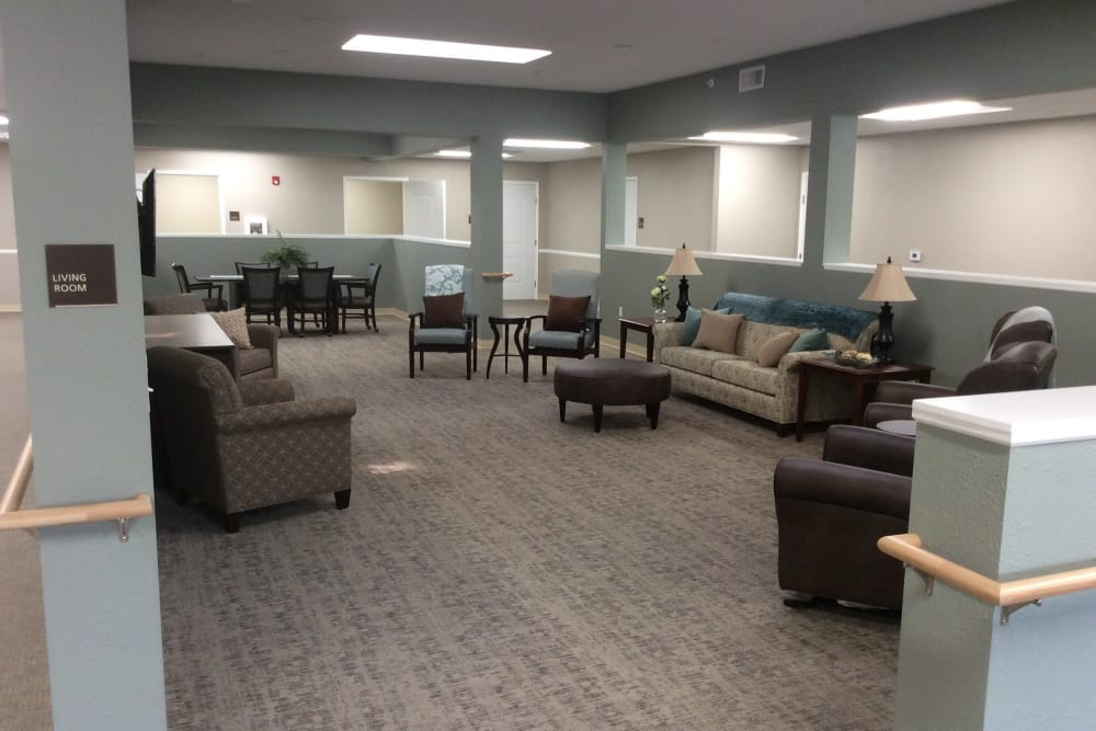 Open living room with lots of space and seating at Serenity in East Peoria, Illinois