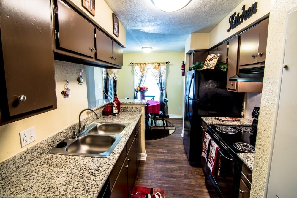 Well-lit kitchen at Cedar Ridge Apartments