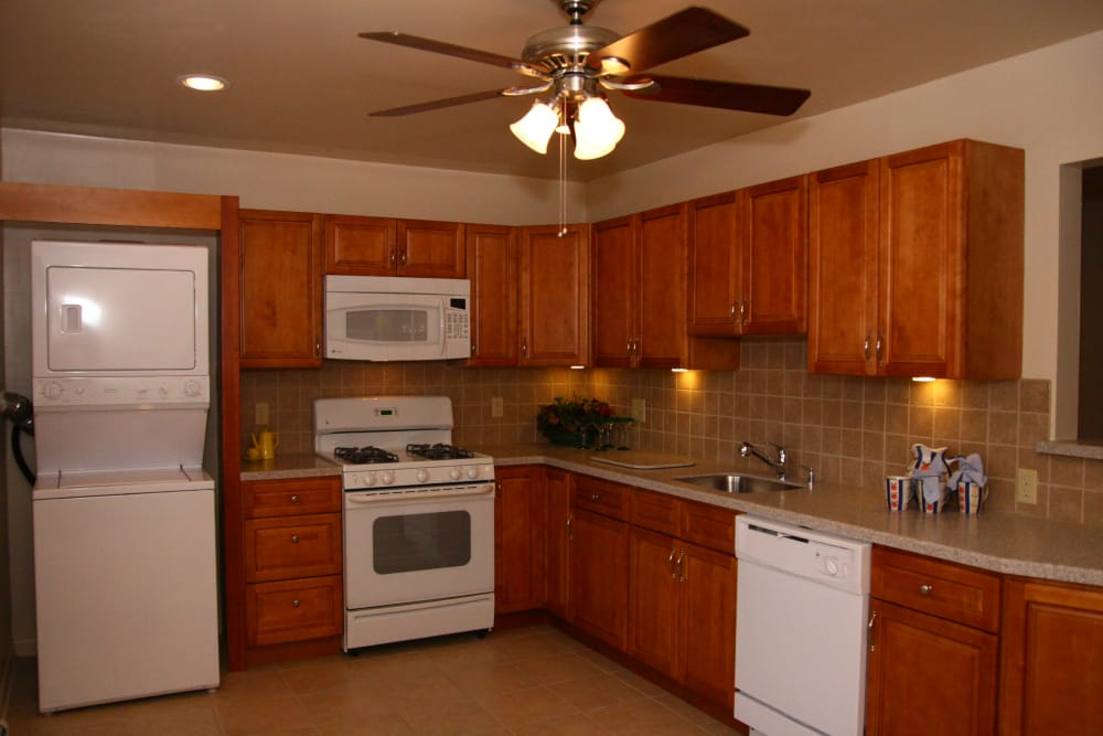 Spacious kitchen with ceiling fan at Cedar Village in Cedar Grove, NJ