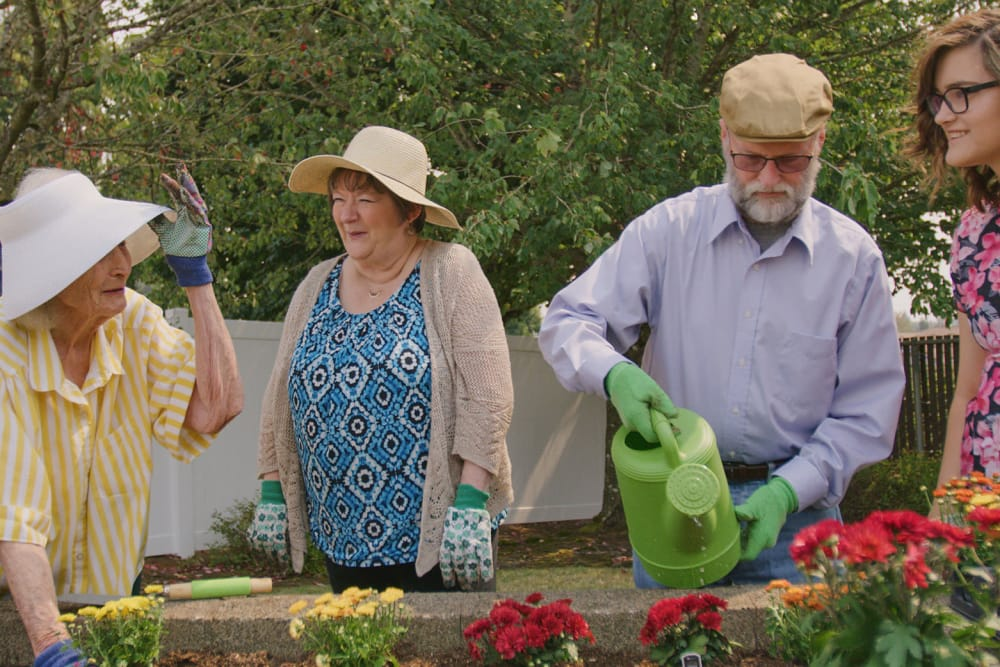 Residents gardening at Arbors Memory Care in Sparks, NV