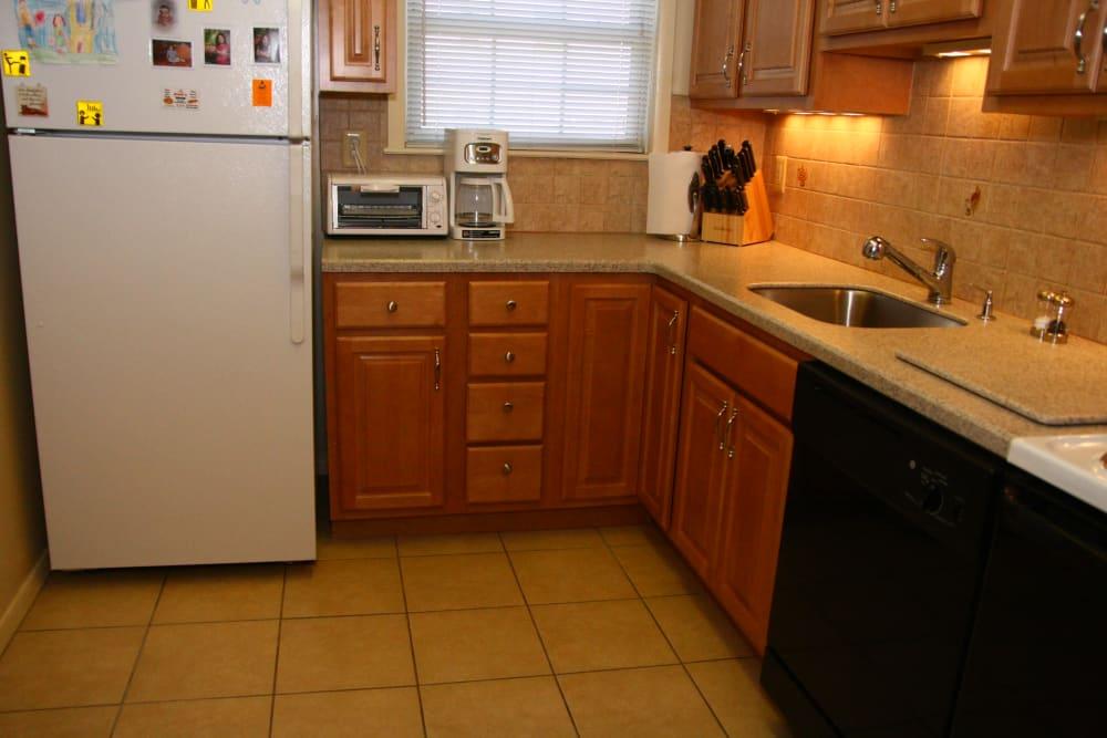 Spacious kitchen with white refrigerator at Cloverdale Associates