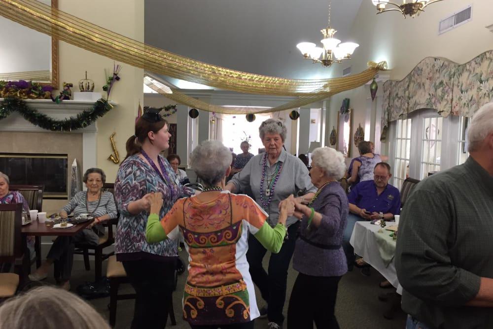 A group of women at Azalea Estates of Monroedancing in a circle in Monroe, LA