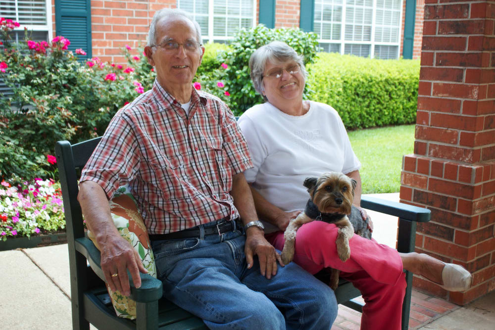A retirement living couple and their pet at Azalea Estates of Monroe in Monroe, LA