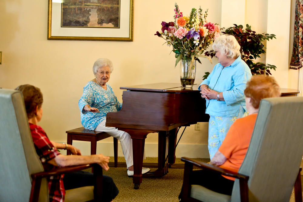 A resident of Azalea Estates of Monroe playing piano for her peers in Monroe, LA
