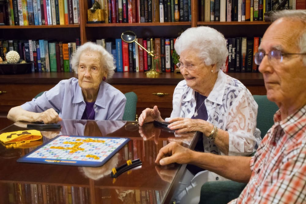 Seniors at the library playing games at Azalea Estates of Monroe in Monroe, LA