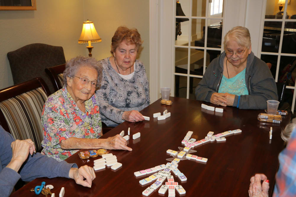 Residents playing a game in the library at Azalea Estates of Monroe in Monroe, LA