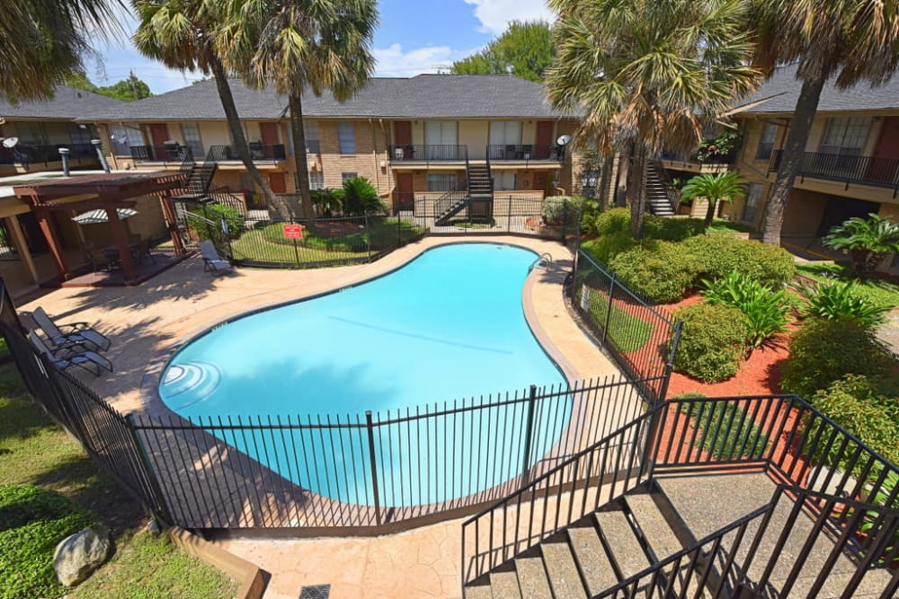 Beautiful swimming pool at Palms at Chimney Rock Apartments in Houston, Texas