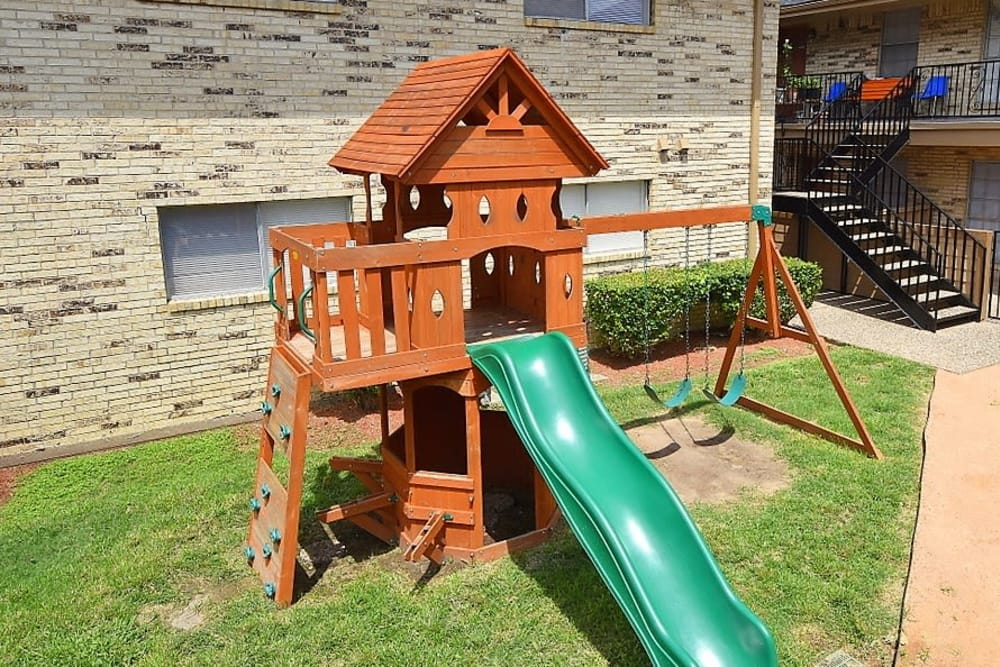 A playground that is great for entertaining at Palms at Chimney Rock Apartments in Houston, Texas