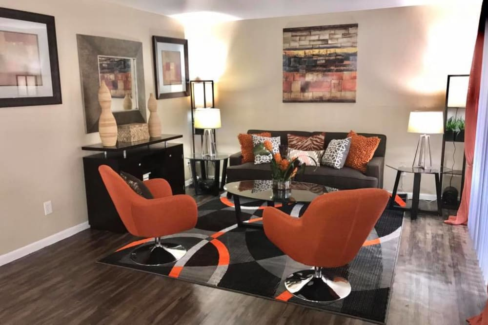 Newly updated living room at Palms at Chimney Rock Apartments in Houston, Texas
