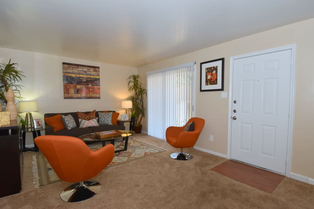Enjoy apartments with a modern living room at Palms at Chimney Rock Apartments in Houston, TX