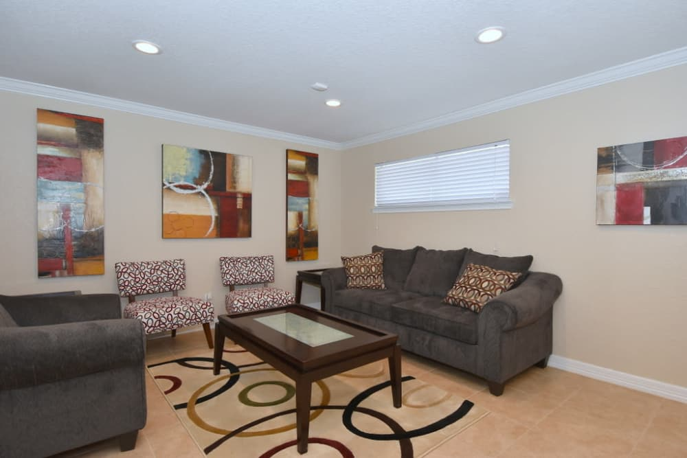 Palms at Chimney Rock Apartments offers a luxury living room in Houston, Texas