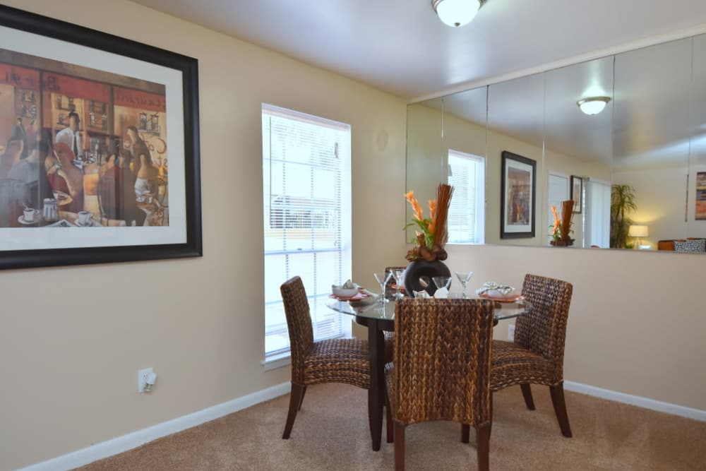 Renovated dining room at Palms at Chimney Rock Apartments in Houston, Texas