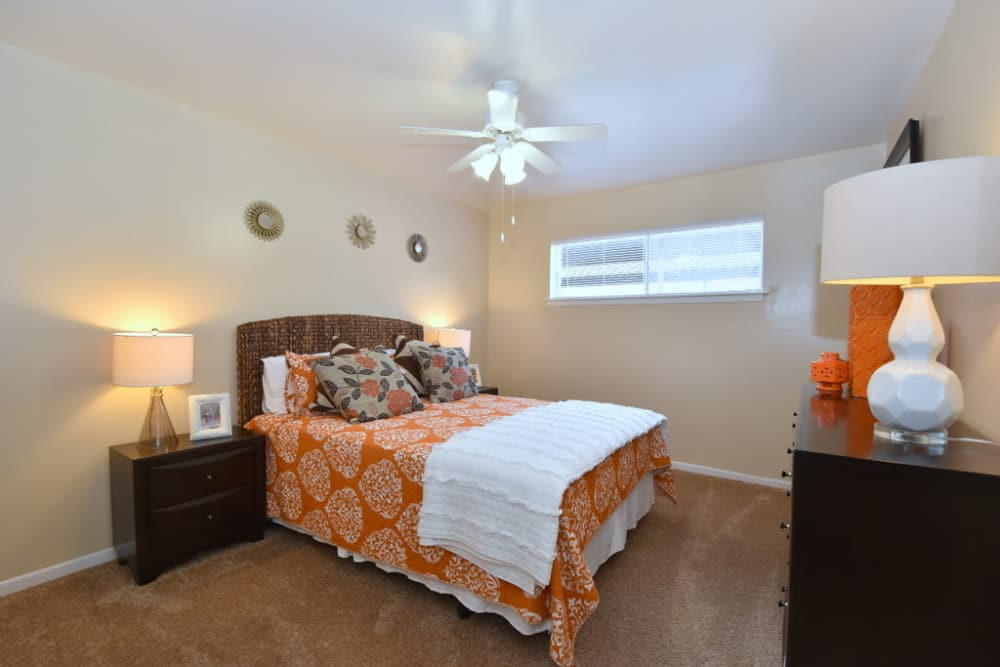 Cozy bedroom at Palms at Chimney Rock Apartments in Houston, Texas