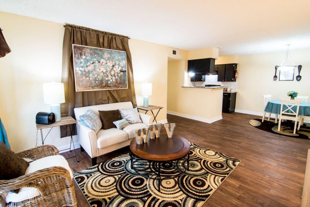 Westwood Village Apartments living room with hardwood floors in Rosenberg, TX