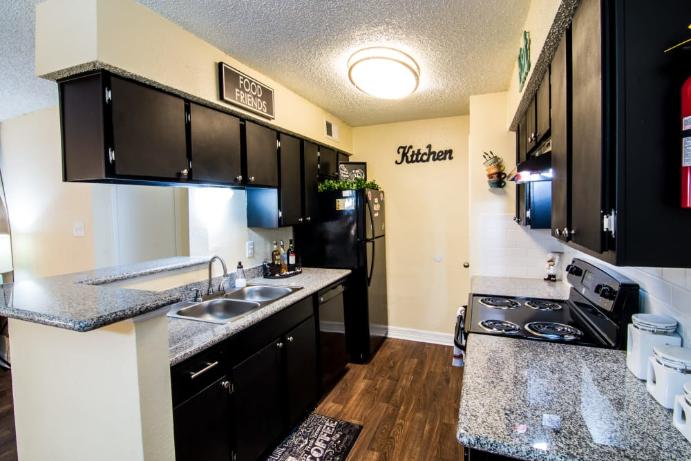 Well equipped kitchen at Westwood Village Apartments in Rosenberg, TX