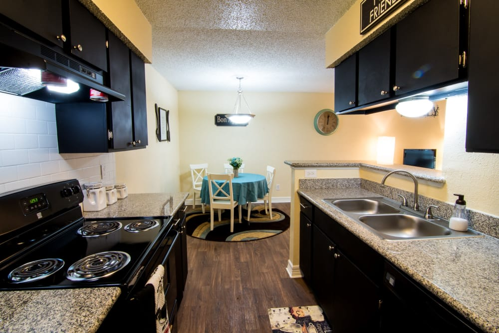 Well-lit kitchen at Westwood Village Apartments in Rosenberg, TX