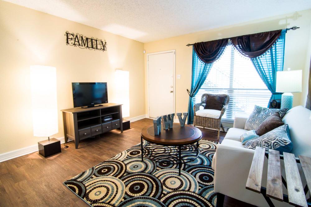 Sun-lit living room at Westwood Village Apartments in Rosenberg, TX