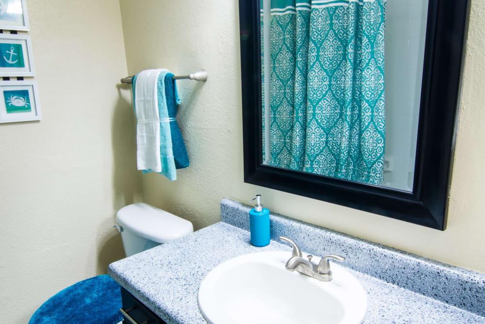 Bathroom vanity at Westwood Village Apartments in Rosenberg, TX