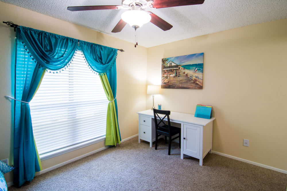 Well-lit room at Westwood Village Apartments in Rosenberg, TX