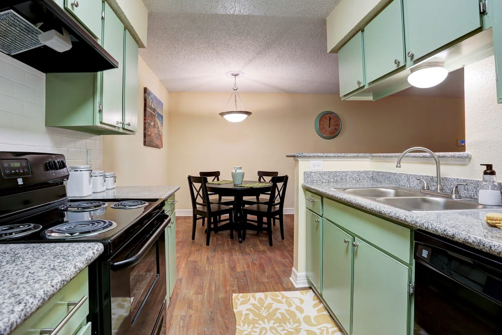 Kitchen and dining room at Westwood Village Apartments in Rosenberg, TX