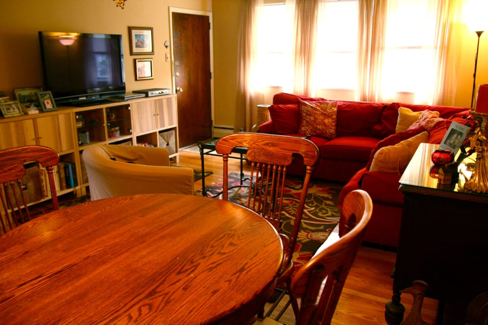 Dining room and living room with TV at Haddon Knolls Apartments