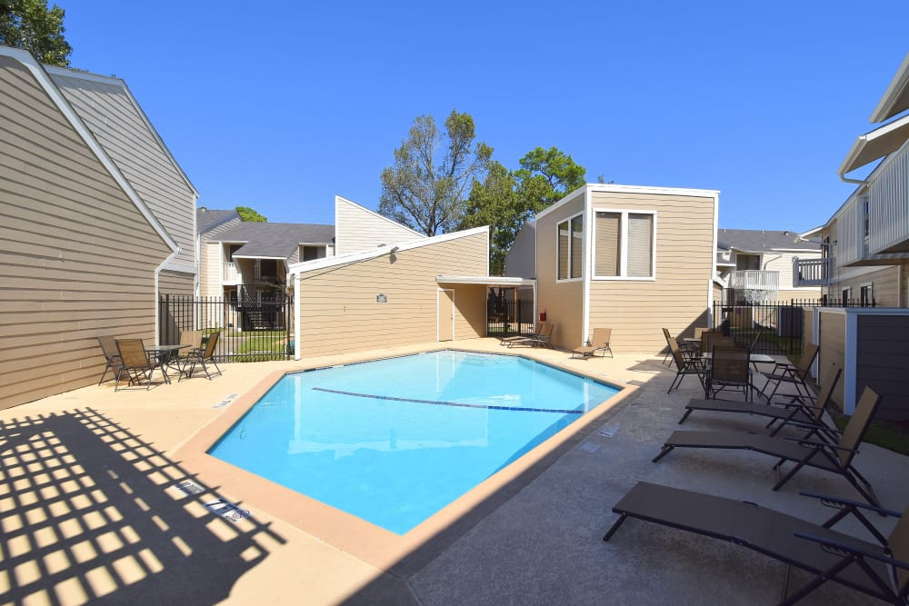 A swimming pool that is great for entertaining at Waterchase Apartments in Humble, Texas