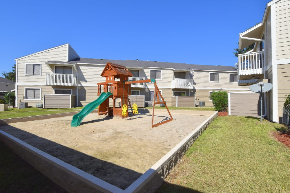 Waterchase Apartments offers a spacious playground in Humble, Texas