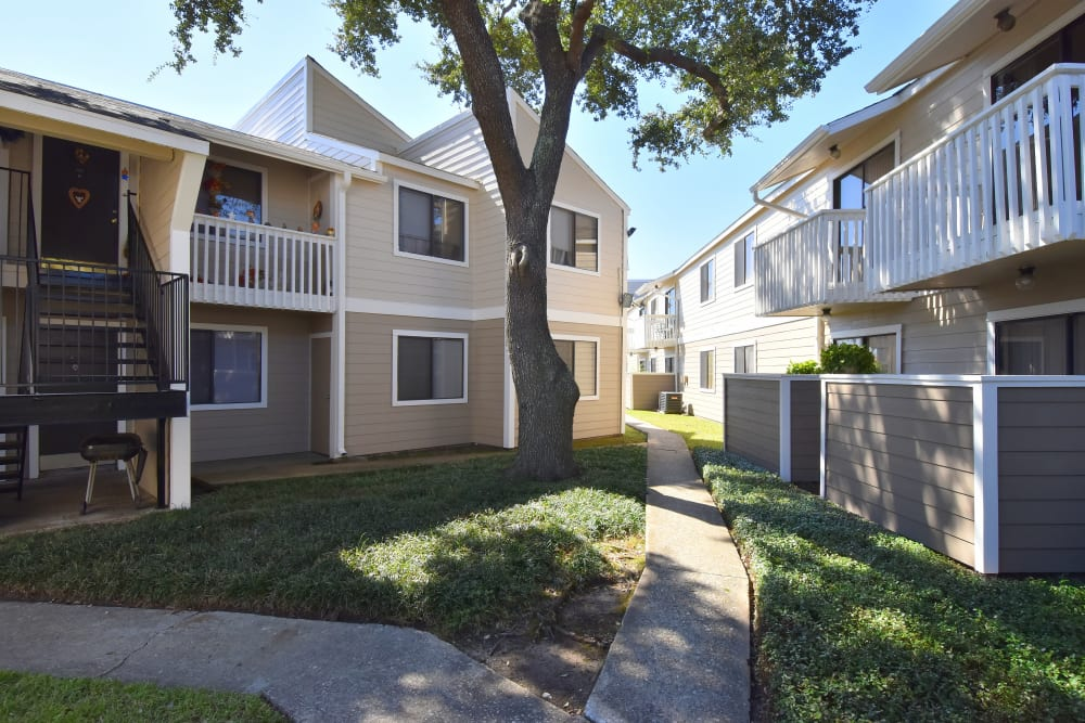 Enjoy green areas around the breezeway at Waterchase Apartments in Humble, TX