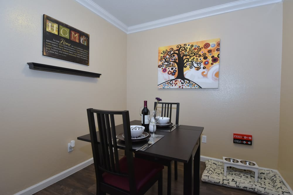 Apartments with a cozy dining area at Park at Deerbrook Apartments