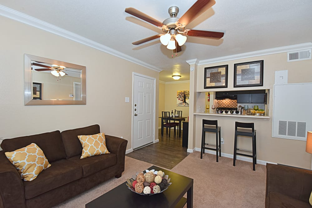 Park at Deerbrook Apartments living room with ceiling fan in Humble, TX