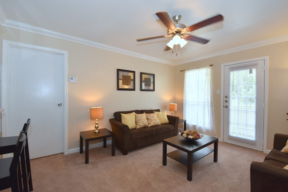 Park at Deerbrook Apartments offers a cozy living room in Humble, Texas